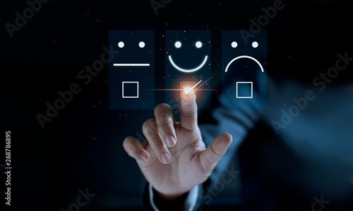 Fotografie, Tablou Finger of businessman touching and check mark icon face emoticon smile on dark background, service mind, service rating