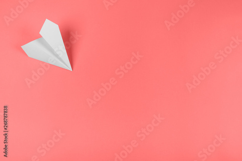 Fototapety, obrazy: White paper airplane on the corner of the coral background