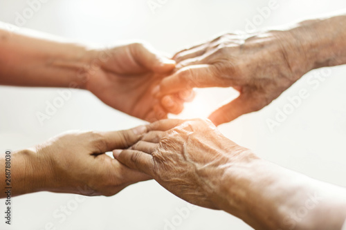 Close up hands of helping hands elderly home care Canvas Print