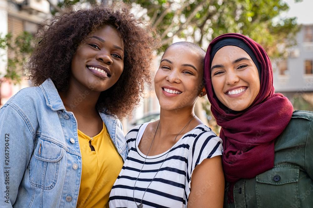 Fototapeta Multiethnic young friends enjoying together