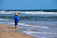 Unrecognizable Person Surf Fishing Hoping To Catch A Fish At St. Augustine, Florida