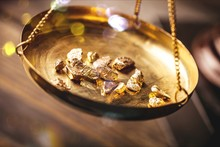 Small Gold Nuggets In An Antique Measuring Scale