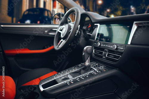 Expensive car interior with steering wheel, multimedia and gearbox handle Wallpaper Mural