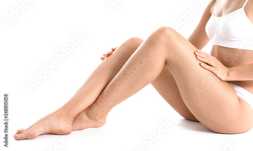 Fotografie, Obraz  Beautiful young woman after laser hair removal of legs on white background