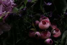 Close Up Of Beautiful Artificial Flowers Peonies. Plastic Realistic Flowers And Plants Wall Background.