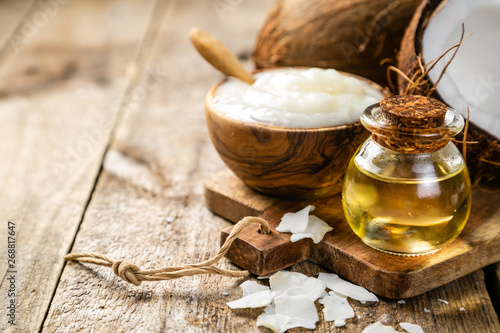 Fototapeta MCT coconut oil concept - coconuts, butter and oil on wood background, copy space obraz