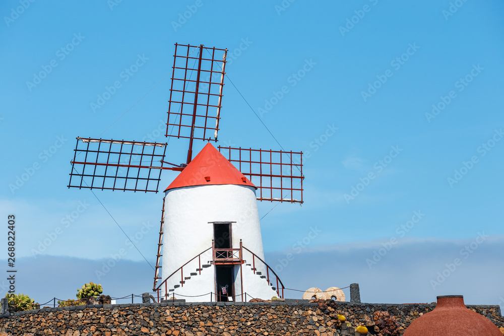 Fototapety, obrazy: Windmill on blue sky background in cactus garden, Guatiza village, Lanzarote, Canary islands
