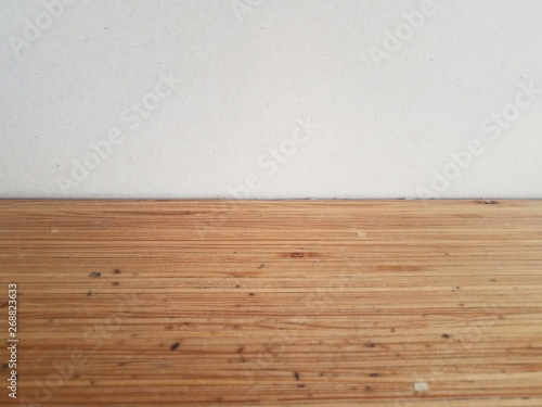 brown wood table or surface with white wall