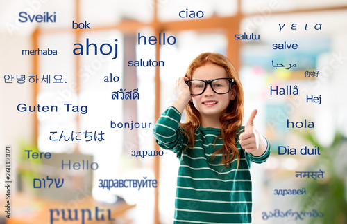 Fotografía  education, translation and learning concept - smiling red haired student girl in