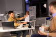 business, deadline and technology concept - software developers discussing user interface design mockup at night office