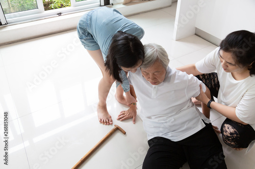 Canvastavla Asian elderly woman with walking stick on floor after falling down and caring wo