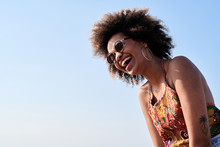 Happy Woman Laughing Over The Sky.