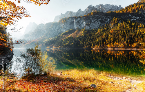 Foto auf Leinwand Wasserfalle Amazing Alpine valley in Austrian Alps at Sunny day. Incredible Autumn Landscape with famous Lake Gosausee, and Dachstein glacier on background. Top Popular place for photographers and travelers.