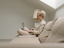 Relaxed Woman With Laptop On S...
