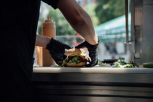 Food: Burger Being Prepared At A Food Truck