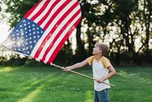 Boy Waving An American Flag