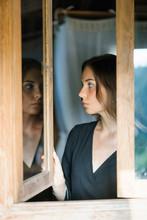 Tender Woman In Opened Wooden Window