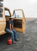 Cowgirl On Side Of Road Out Of Gas