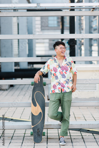 Young asian man with skateboard