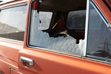 Car Window Smashed By A Thief. Car Broken Window. Broken Right Side Window Of A Car Parked On The Street. Theft From The Car. A Criminal Incident. The Car After The Accident
