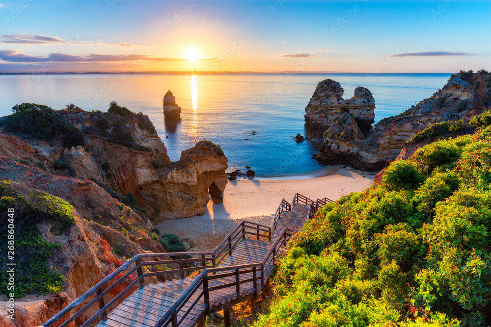 Fototapety, obrazy: Camilo Beach (Praia do Camilo) at Algarve, Portugal with turquoise sea in background. Wooden footbridge to beach Praia do Camilo, Portugal. Wonderful view of Camilo Beach in Lagos, Algarve, Portugal.