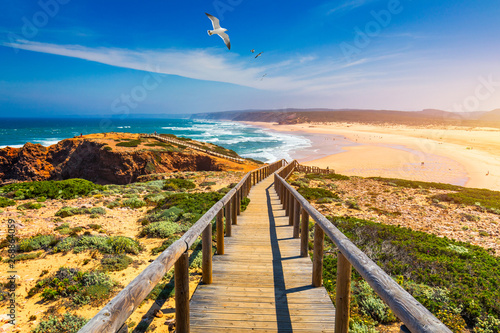Fotomural Praia da Bordeira and boardwalks forming part of the trail of tides or Pontal da Carrapateira walk in Portugal