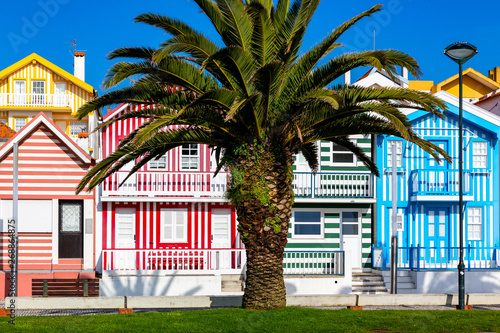 Foto op Plexiglas Stadion Street with colorful houses in Costa Nova, Aveiro, Portugal. Street with striped houses, Costa Nova, Aveiro, Portugal. Facades of colorful houses in Costa Nova, Aveiro, Portugal.