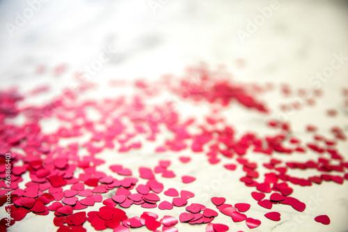 Fotobehang Macrofotografie Heart Shaped Glitter Confetti on a Marble Slab