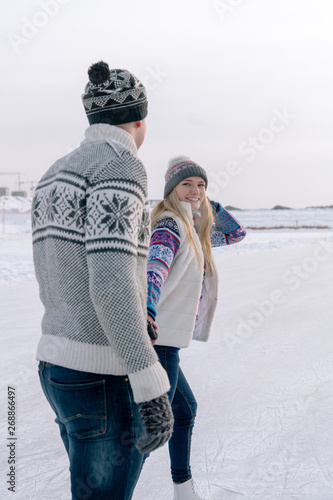 Romantic couple skating on rink