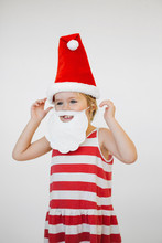 Cute Girl In Fake Santa Costum...