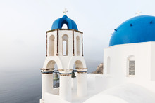 Orthodox Church With Blue Dome On Santorini