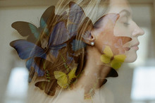 Double Exposure Portrait Of A Woman With Butterflies