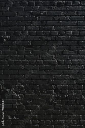 Old brick wall painted black - 268871802