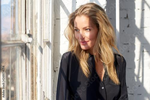 Fotografie, Obraz Attracitve blond woman close-up portrait