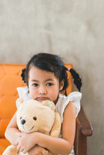 Asian Kid With Her Teddy Bear ...