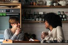 Two Beautiful Girls Chatting W...