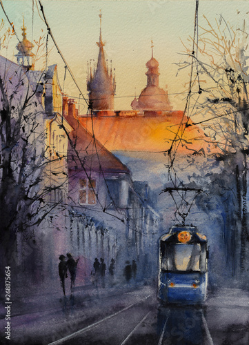 Fototapeta Blue tram at sunrise with castle Wawel in background in Krakow, Poland. Picture created with watercolors. obraz
