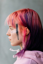 Woman With Tattoo On Her Face