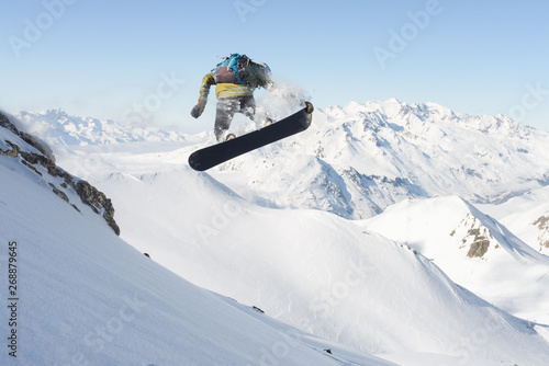 Snowboarder jumping in the air