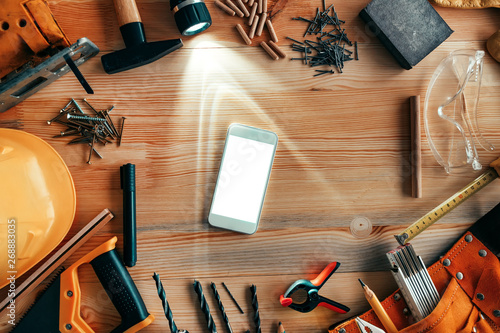 Poster Fleur Smartphone mock up on carpentry woodwork workshop desk