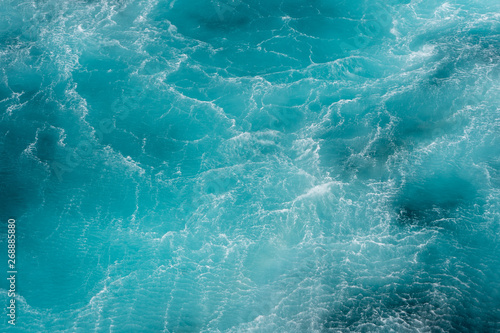 Fotomural  Turbulence flow of sea water happen by the helicopter hop over the water surface