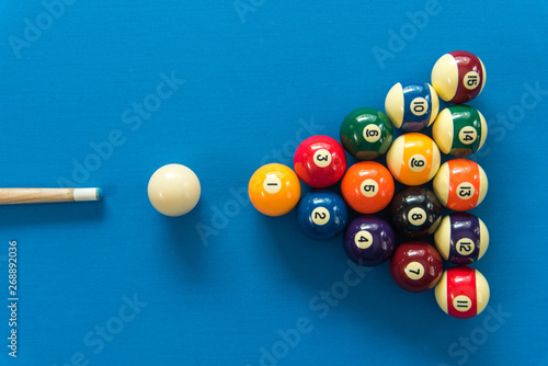 Canvas pool or billiards balls on light blue table