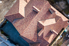 Top Aerial View Of Building Complex Shingle Roof Construction. Abstract Background.