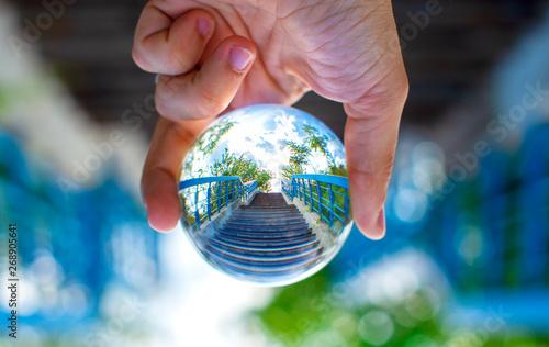 Obraz Blue stairs through the lensball - fototapety do salonu