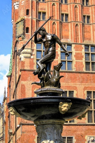 The Neptune, bronze statue of the Roman God of the Sea (Poseidon in Greek mythology) located in the Old Town of Gdansk, Poland Wallpaper Mural