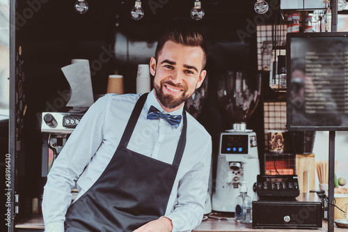 Fotografie, Obraz  Groomed elegant barista is waiting for customers at his own small coffeeshop