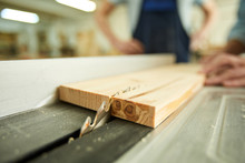 Closeup Of Unrecognizable Carpenter Cutting Wood Using Disksaw In Joinery Workshop, Copy Space