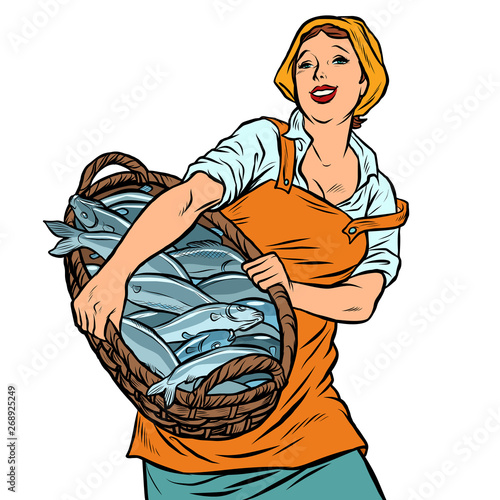 Fototapeta woman fisherman with a basket of fish. oceanic herring and cod
