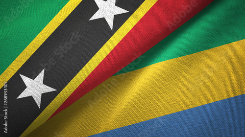 Fotografie, Obraz  Saint Kitts and Nevis and Gabon two flags textile cloth, fabric texture