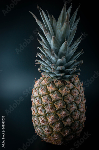 Fototapety, obrazy: pineapple on an isolated black background
